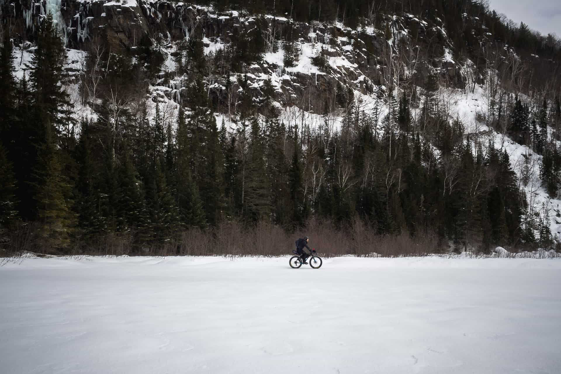 A man riding a fatbike on a frozen lake
