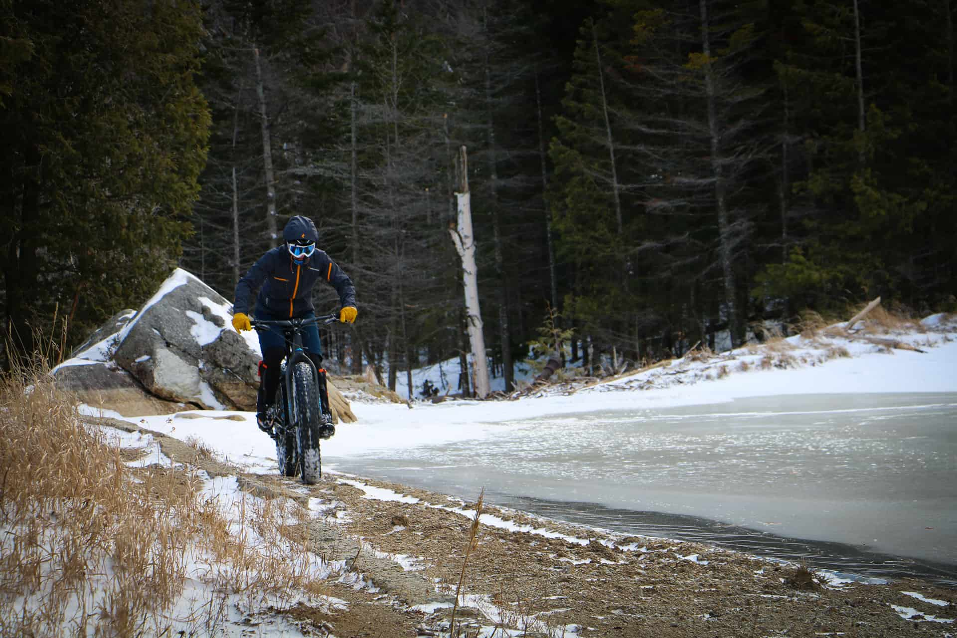 Lady on fatbike going up icy road