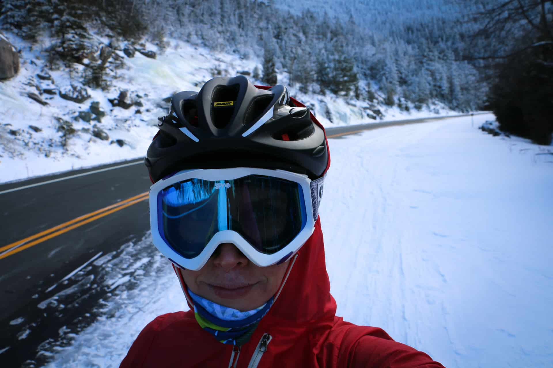 A female fatbike rider with a frozen face after whiteface mountain ascent